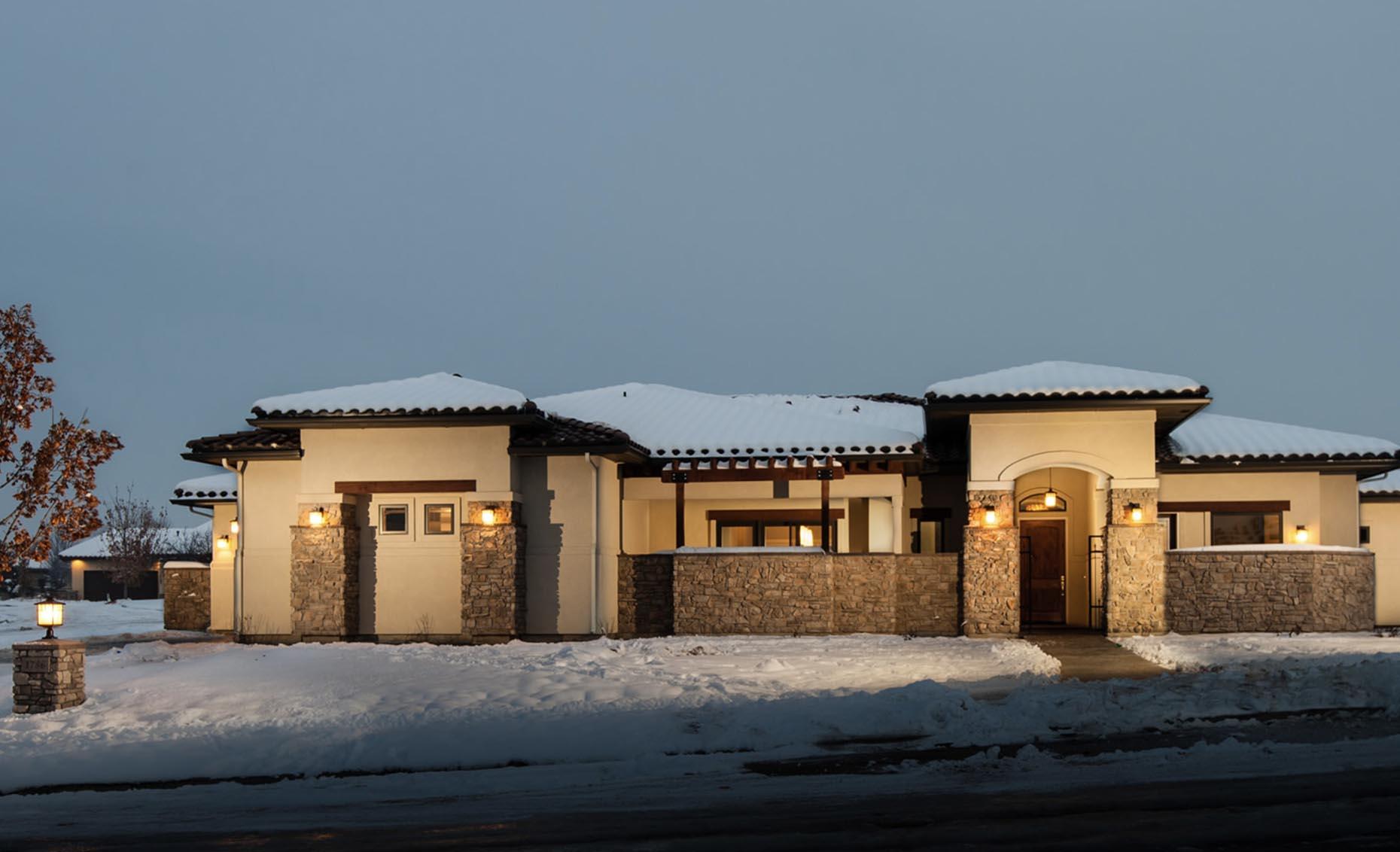 The Corrente Bello House Exterior on a Snowy Evening