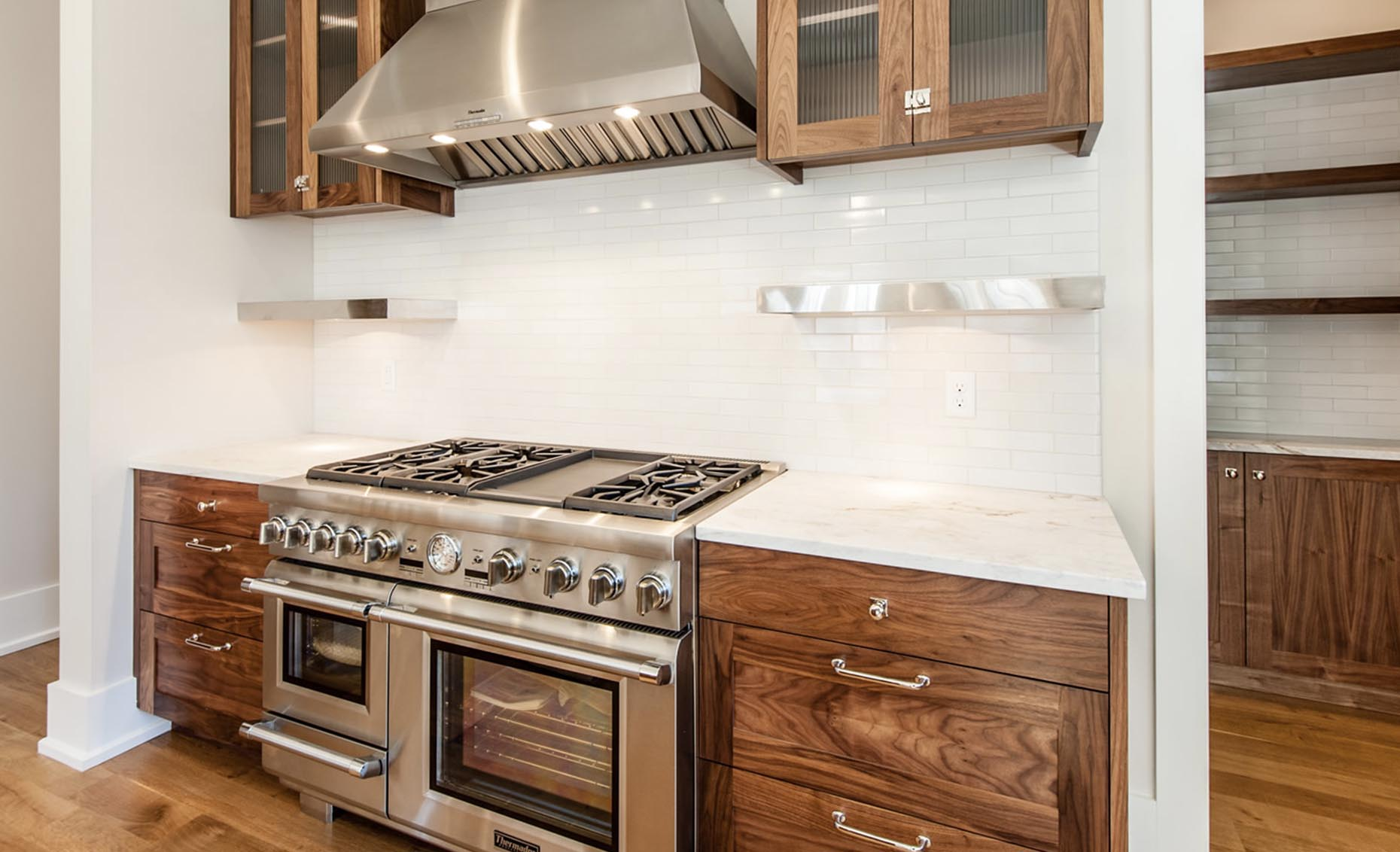 The Bungalow House Kitchen with Stainless Steel Gas Range